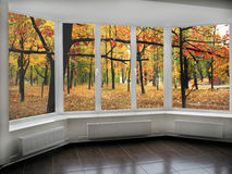 Panoramic windows with view to oaken autumnale grove. Big panoramic windows with view to oaken autumnale forest Stock Photography