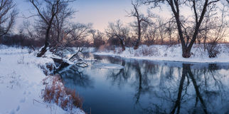 Panoramic winter landscape with trees, beautiful frozen river at royalty free stock photos