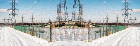 Panoramic Winter Pylons  Scene. Electrical tower pylon, post and wires on a blue sky Royalty Free Stock Images