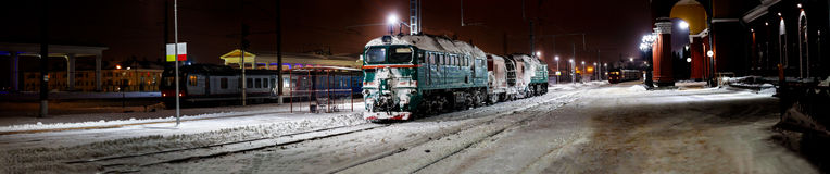 Panoramic winter view on railway station Stock Photos