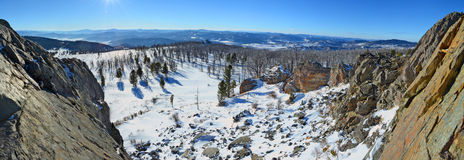 Panoramic winter view from the rocky ledge in the Altai mountains, Siberia, Russia.  Royalty Free Stock Photography