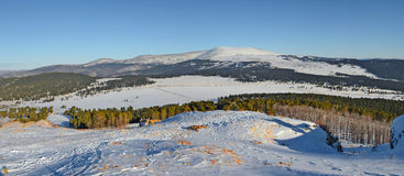 Panoramic winter view of the snow-capped peaks in the Altai mountains, Siberia, Russia Royalty Free Stock Photos
