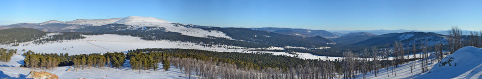 Panoramic winter view of the snow-covered slopes of the Altai mountains, Siberia, Russia Stock Photography