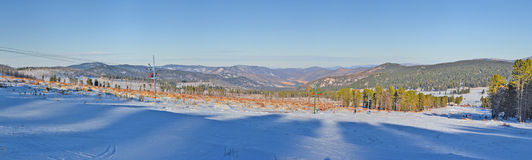 Panoramic winter view of the snow-covered slopes of the Altai mountains, Siberia, Russia.  Royalty Free Stock Image