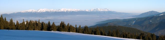 Panoramic wintry view of High Tartas mountains. From Fatra mountains Stock Image