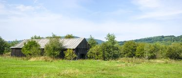 Panoramic wooden abandoned farm Royalty Free Stock Image