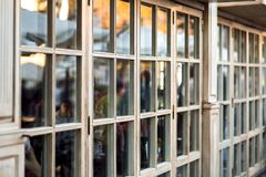 Panoramic wooden windows showcase a cafe shop. Panoramic wooden windows showcase a cafe shop in retro style, the window frame made of wood is a close-up of the stock images