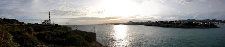 Panoramische zonsondergang en vuurtoren Royalty-vrije Stock Afbeeldingen