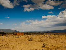 Panoramma savanna with the sky and the mountain. Steppes view of the sky and the mountains on the background of the stockade Stock Photography