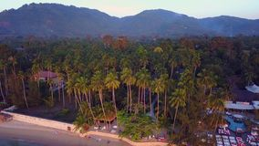 Panormanic view over the Thailand palm trees and a beach club. Panormanic view over the island of Koh Samui in Thailand palm trees and a beach club stock footage