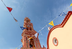 Panormitis Monastery bell tower and flags. Symi island, Greece. royalty free stock image