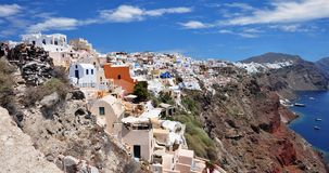 Panoromic view from the town of Santorini Island, Fira from above. Greece. On Santorini Island Fira is typical blue domes lined up on the volcano side in Oia Stock Photos
