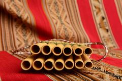 Panpipes from South America with focus on foreground. Panpines from South America with focus on the the foreground Royalty Free Stock Photo