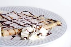 Panqueca com chocolate e creme Foto de Stock Royalty Free