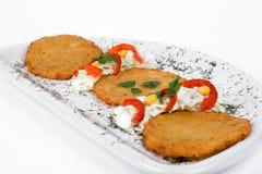 Panqueca da batata/bolo do Griddle na placa isolada Imagem de Stock