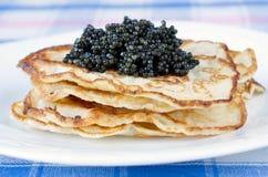 Panquecas com caviar Foto de Stock Royalty Free