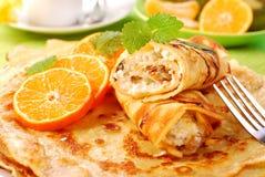 Panquecas com com queijo e laranja de casa de campo Imagem de Stock Royalty Free