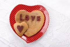 Panquecas dadas forma coração imagens de stock