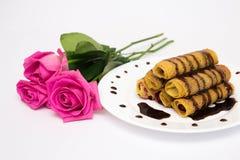 Panquecas e rosas Imagens de Stock Royalty Free
