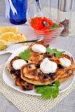 Panquecas fritadas com groselha Imagem de Stock