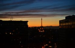 DUSK NIGHT Panorama city view of Paris, Eiffel tower, taken from tradition french style room, statue royalty free stock photography