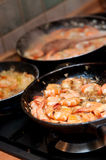 Pans of Cooking Shrimp. Metal pans on stove top filled with shrimp Stock Photos