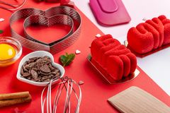 Free Pans Hearts Mold, Whisk, Eggs, Wooden Spatula And Grated Chocolate. Ingredients To Making Festive Cake. Valentines Day Bakeware Stock Photography - 138454692