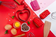 Free Pans Hearts Mold, Whisk, Eggs, Wooden Spatula And Grated Chocolate. Ingredients To Making Festive Cake. Valentines Day Bakeware Royalty Free Stock Images - 138454879