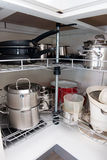 Pans in the kitchen. All cooking Pans in the kitchen cabinet royalty free stock photography