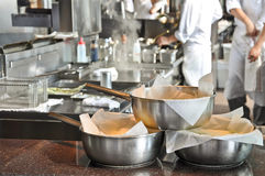 Pans in a kitchen. Pans in a restaurant kitchen stock photo