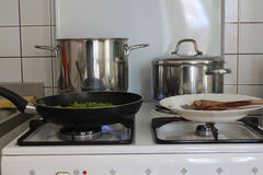 Pans in kitchens. To cook Royalty Free Stock Photos