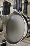 Pans in shop Stock Photos