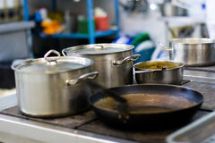 Pans on the stove Stock Photography