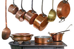 Pans and stove. Pans and kitchen utensils in copper stock image