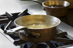 Pans on the stove Royalty Free Stock Photos
