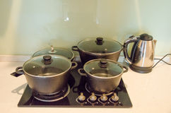 Pans on stove and kettle Stock Photo