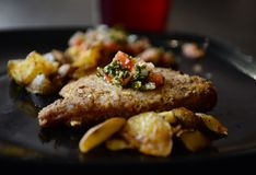 Panseared fish with potatoes Royalty Free Stock Photos