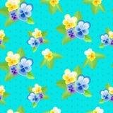 Pansies auf einem blauen Hintergrund mit Punkten Stockfotos