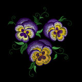 Pansy embroidery flower patch. Stitch texture effect. Traditional floral fashion decoration. Purple violet yellow color black back Stock Image
