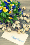 Pansy flowers, quail eggs and greeting card Stock Image