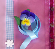Pansy head on pink textil background Stock Images