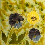Pansy Tile. A Victorian Art Nouveau period tile c1890 in majolica glaze with pany flowers stock photos