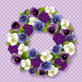 Pansy Wreath. Spring Pansy wreath with Viola flowers in purple, lavender, blue and white. White polka dots on pastel lavender background. EPS8 compatible Stock Photo