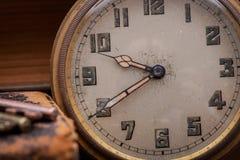 Panta rhei concept: Antique pocket watch, vintage keys and pile of old books on natural cork.