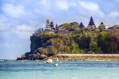 Pantai Pandawa beach and temple on a cliff, Bali, Indonesia stock photography