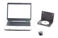 Pantalla blanca en computadora portátil y rectángulo de DVD imágenes de archivo libres de regalías
