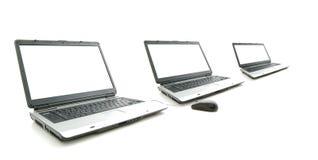 Pantalla blanca en la computadora portátil tres imágenes de archivo libres de regalías