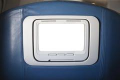 Pantalla cortada de la parte posterior de asiento de la primera clase TV Fotos de archivo libres de regalías