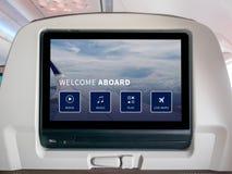 Pantalla de aviones del entretenimiento, pantalla de aviones, pantalla del Seatback en aeroplano fotos de archivo libres de regalías