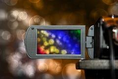 Pantalla de visualización del LCD en una alta cámara de televisión de la definición, fondo del bokeh de la película colorido Imagen de archivo libre de regalías